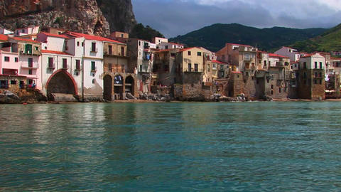 Ocean water near beach houses in Cefalu, Italy Footage