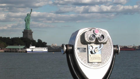 A tourist telescope overlooks the Statue of Liberty Stock Video Footage