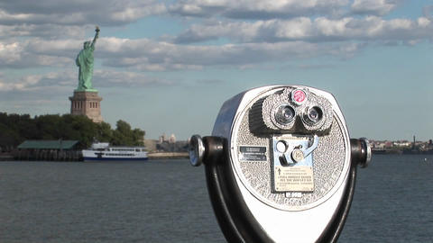 A tourist telescope overlooks the Statue of Liberty Footage