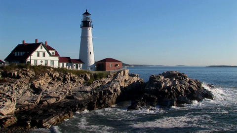 The Portland Head Lighthouse oversees the ocean from rocks in Maine, New England Footage