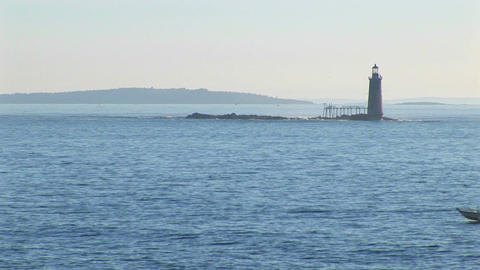 The Portland Head Lighthouse sits on a small island off... Stock Video Footage