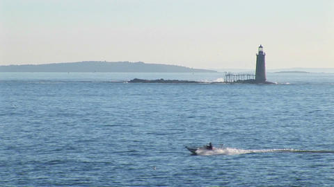 The Portland Head Lighthouse sits on a small island off the Main, New England shore Footage