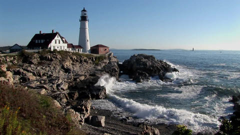 The Portland Head Lighthouse oversees the ocean from... Stock Video Footage