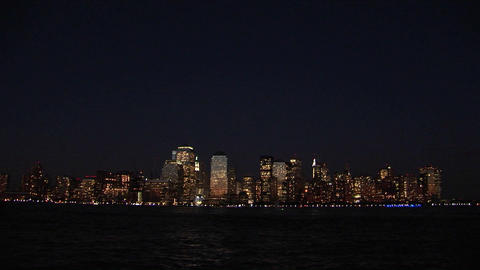 The New York City, NY skyline glows at night Footage