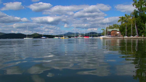 A cloudy blue sky and sailboats are seen in the distance... Stock Video Footage