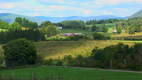A landscape of green rolling hills in Vermont Live Action