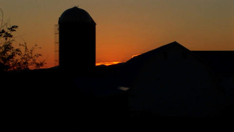 A beautiful time lapse over a barn in the countryside Footage