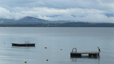Clouds cover a mountain range in the distance of diving... Stock Video Footage