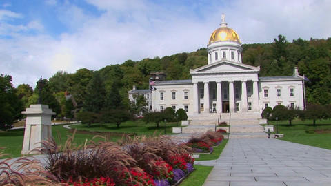 A stone walkway leads to the gold domed capital building in Montpelier, Vermont Live Action