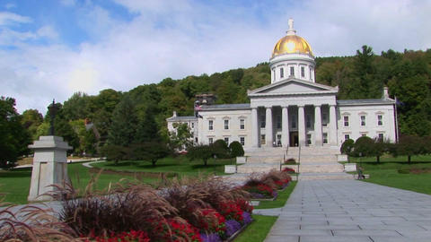 A stone walkway leads to the gold domed capital building... Stock Video Footage