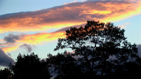 A time lapse of multi-colored clouds above the silhouette... Stock Video Footage