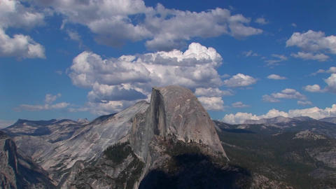 A time lapse of white clouds over a blue sky and rocky... Stock Video Footage