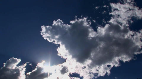 A time lapse of white clouds moving across a blue sky Stock Video Footage