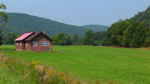 A cabin in the middle of a green field near the Allegheny Mountains in West Virginia, Pennsylvania Live Action