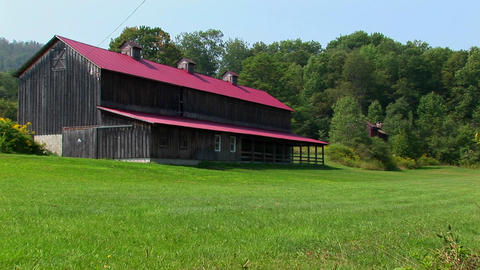 A barn in the middle of a green field near the Allegheny Mountains in West Virginia, Pennsylvania Footage