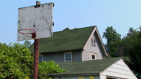 An old basketball hoop near a house Stock Video Footage