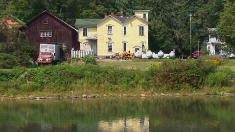 Rural American houses located across a stream at day Stock Video Footage