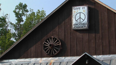 A brown barn with a peace sign in Woodstock, New York Stock Video Footage