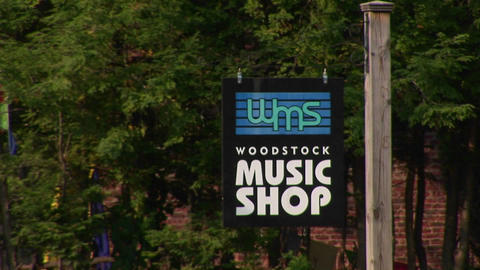 A Woodstock music shop sign in Woodstock, New York Stock Video Footage