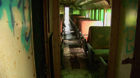 Passenger seats in an abandoned railcar Live Action