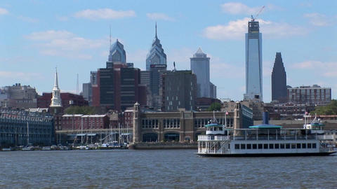 A ferry passes by Philadelphia, Pennsylvania at day Stock Video Footage