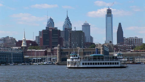 A ferry passes by Philadelphia, Pennsylvania at day Footage