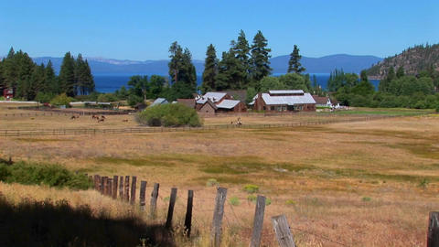 A farm in Lake Tahoe sits near a lake in the Sierra Nevada mountains Footage
