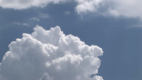A time lapse of thunderclouds expanding in a blue sky Stock Video Footage