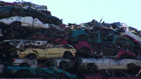 Stacks of vehicles in a junkyard Footage