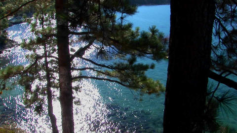 Aqua colored water in Lake Tahoe shimmers in the sunlight... Stock Video Footage