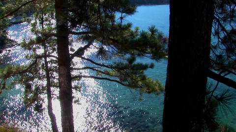 Aqua colored water in Lake Tahoe shimmers in the sunlight near the Sierra Nevada mountains Footage