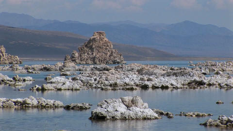 Water in Mono Lake, California touches tufa formations along a shoreline Footage