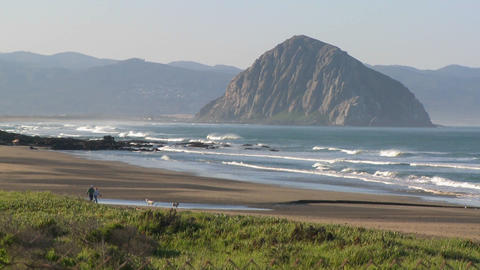 An establishing shot of a large rock along the coast of... Stock Video Footage