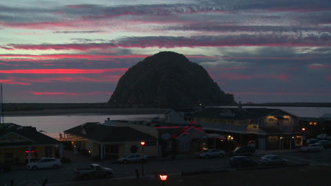 Sunset behind the small California beach town of Morro Bay Stock Video Footage