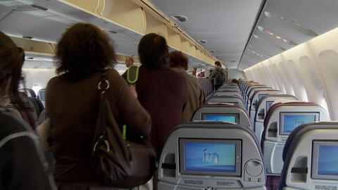 The interior of a modern airplane with passengers boarding Stock Video Footage