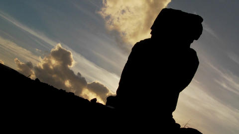 Clouds move mysteriously behind an Easter Island statue Stock Video Footage