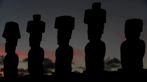 The sun sets behind Easter Island statues Footage