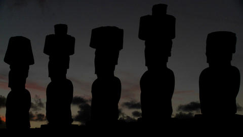 The sun sets behind Easter Island statues Stock Video Footage