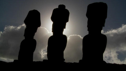 Easter Island statues are silhouetted against the sun Footage
