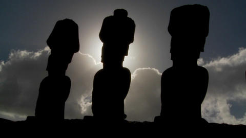 Easter Island statues are silhouetted against the sun Stock Video Footage