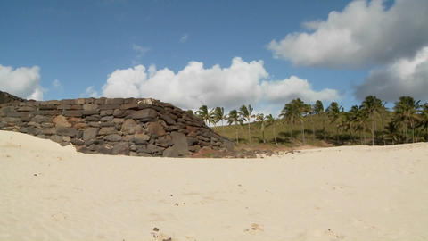 A pan across to Easter Island statues on a beach in the... Stock Video Footage