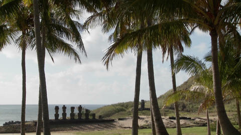 A tilt down to Easter Island statues with the ocean in... Stock Video Footage