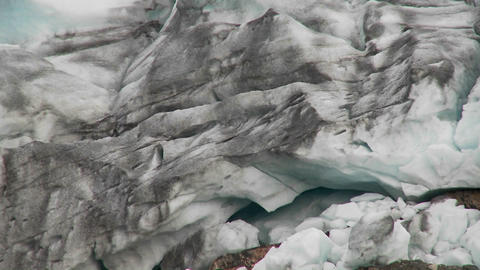 Zoom out from a glacier to reveal how it sculpts the land Stock Video Footage