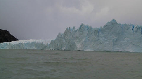POV from a boat traveling along the edge of a glacier Footage