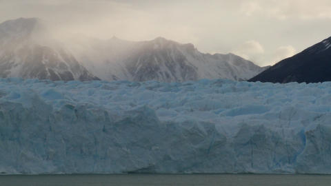 A shot looking across a glacier to mountains in background Footage