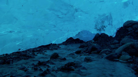 An underground river flows beneath an ice cave Stock Video Footage