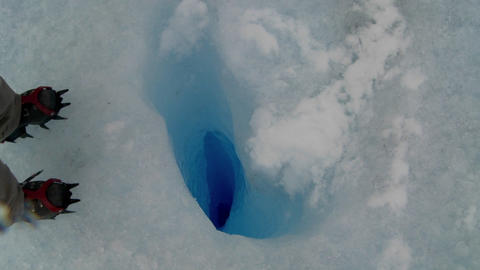 A zoom into a deep blue hole in a glacier Stock Video Footage