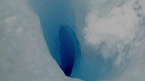A Zoom Into A Deep Blue Hole In A Glacier stock footage