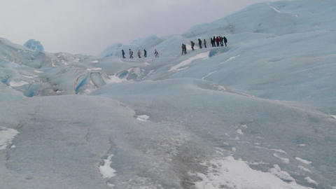 A group of explorers move across a glacier Stock Video Footage