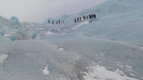 A group of explorers move across a glacier Footage